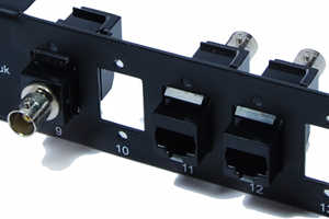[Photo of Single Balun Adapter mounted in a combination panel]